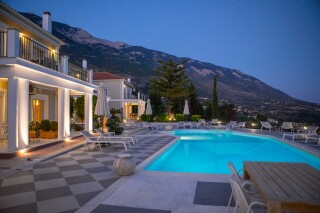 gallery garbis villas pool by night